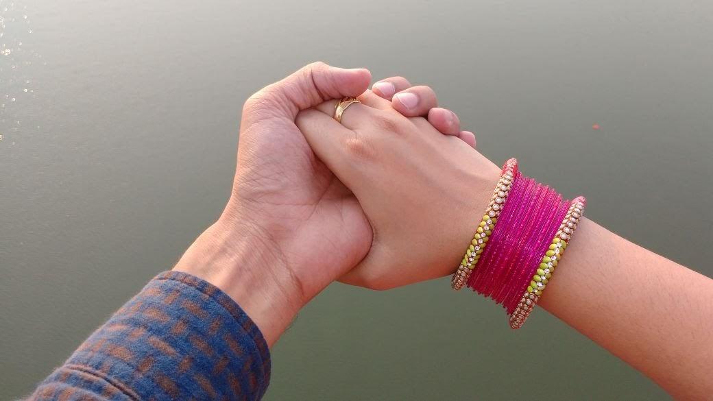 couple hands meeting over river Ganga