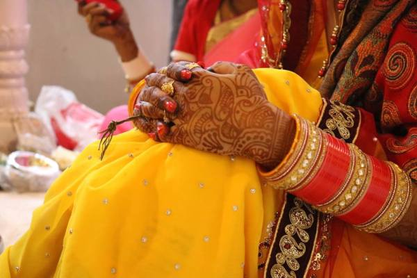Beautiful bride's hands while marriage ceremony