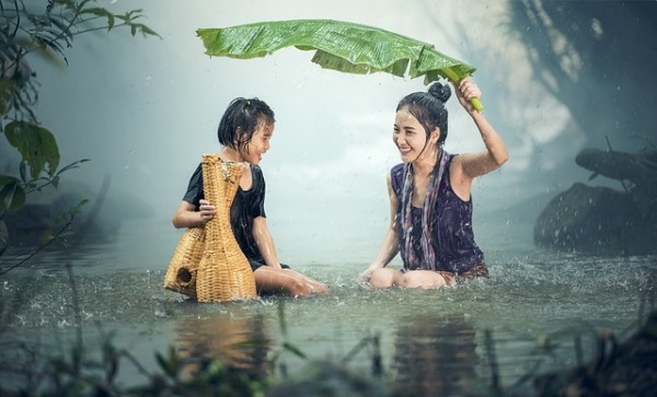 Woman-girl-enjoying-rain