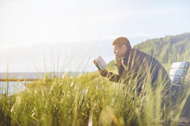 Alone boy reading a book